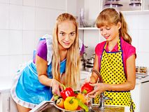 Children washing fruit at kitchen. Stock Photos