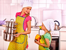 Children washing fruit at kitchen. Stock Photography