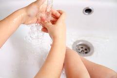 Children washing hands Stock Image
