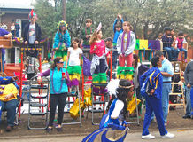 Children Watch the Parade From Mardi Gras Ladders Stock Image
