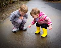 Children watch worm stock photo