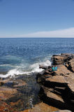 Children watching crashing waves. At Schoodic penisula in Acadia National Park Maine Stock Photography