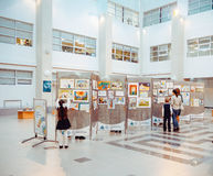 Children watching the exhibition of drawings Stock Photography