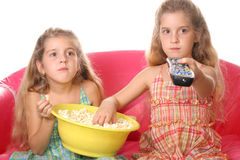Children watching a movie eati. Shot of children watching a movie eating popcorn Royalty Free Stock Image