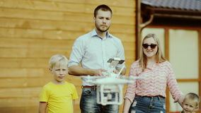 Children watching Quadcopter Drone stock footage