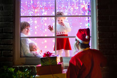 Children watching Santa on Christmas eve Royalty Free Stock Photos
