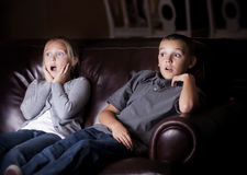 Children watching Shocking Television Programming Stock Photography