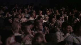 Children watching a show at the theatre 1. stock video footage