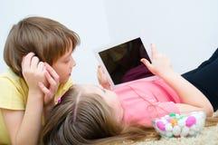 Children watching tablet. PC computer Stock Photos