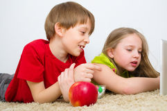 Children watching tablet PC. Happy children watching tablet PC Royalty Free Stock Images