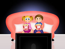 Children watching television Stock Photos