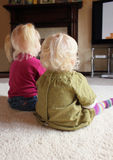 Children watching television together Royalty Free Stock Photography