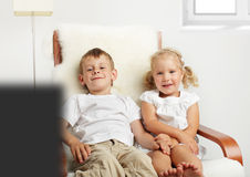Children watching TV Stock Photo