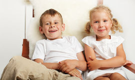 Children watching TV. Brother and sister watching TV at home Stock Photography