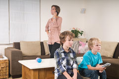 Children watching tv Stock Images