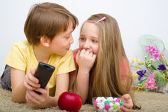 Children watching TV. Holding  control Royalty Free Stock Images