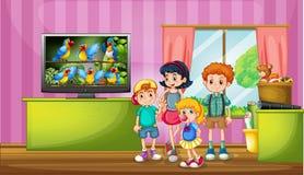 Children watching tv in the room Stock Photo