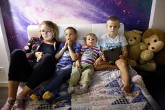 Children watching TV. On sofa at home Stock Image