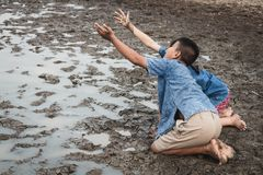 Children and water on arid soil in hot. Children and water on arid soil in hot weather lacked drinking water Royalty Free Stock Photo