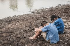 Children and water on arid soil in hot. Children and water on arid soil in hot weather lacked drinking water Royalty Free Stock Photography