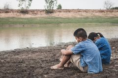Children and water on arid soil in hot. Children and water on arid soil in hot weather lacked drinking water Stock Photos