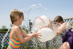 Children in water fight. Royalty Free Stock Photo