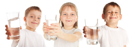 Children with a water glass stock image
