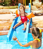 Children on water slide at aquapark. Royalty Free Stock Photo