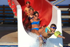 Children on water slide at aquapark Royalty Free Stock Images
