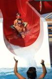Children on water slide at aquapark Royalty Free Stock Photo