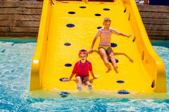Children on water slide at aquapark Stock Photography