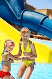 Children on water slide at aquapark. Stock Photography