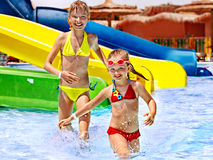 Children on water slide at aquapark. Royalty Free Stock Images
