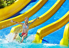 Children on water slide at aquapark. Stock Photos