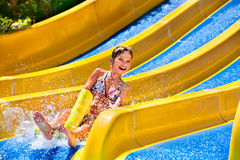 Children on water slide at aquapark Royalty Free Stock Photos