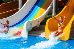 Children on water slide at aquapark. Royalty Free Stock Photos