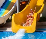 Children on water slide at aquapark. Stock Images
