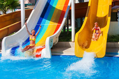 Children on water slide at aquapark. Royalty Free Stock Photos