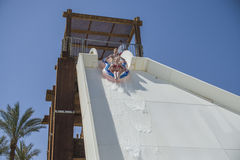 Children in water slide, the boat Stock Photos
