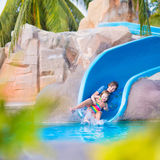 Children on water slide Royalty Free Stock Image