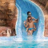 Children on water slide Stock Images