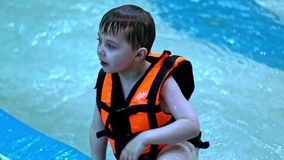 Children in water swimming pool. Boy in swimming pool. Child in swimming pool. stock footage