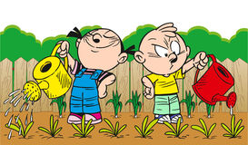 Children watering the garden Royalty Free Stock Images