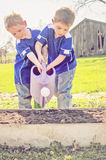 Children watering garden Royalty Free Stock Image