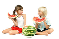 Children with watermelon. Two children  eating watermelon and smile, on white background, isolated Stock Photos