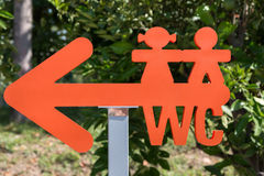Children WC Arrow-shaped Sign: Restroom Symbol Stock Images