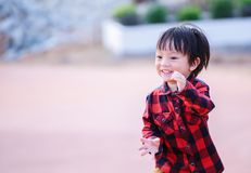 Children wear Jacket to traval and stand in the park. Children smiling. stock images