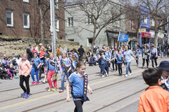 Children wearing bunny ears march along Queen Street in the Beac Stock Photography