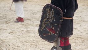 Children wearing historic suits reenacting knights' tournament at theme camp. Stock footage stock video footage