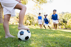 Children wearing soccer uniform playing a match Stock Photo